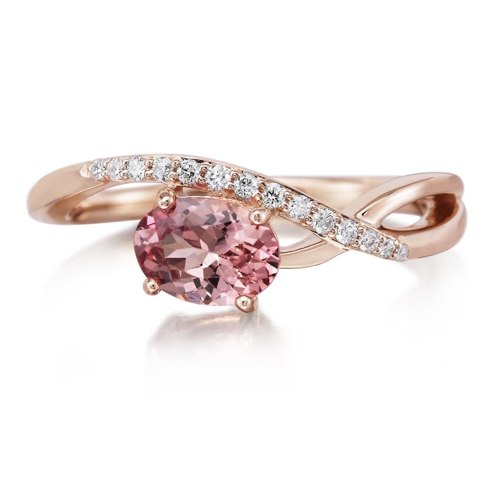 Women's Gemstone Fashion Ring - 14k Rose Gold Lotus Garnet and Diamond Ring. One Oval Lotus Garnet .94ct and 14 round brilliant cut diamond accents .09ct. tw. H-I, SI2  Treatment: N