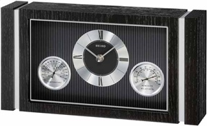 Clock - Seiko Clock      * Solid wooden case with a black finish     * Center dial tells the time     * Hygrometer - displays relative humidity     * Thermometer - displays temperature     * Glass crystal     * One