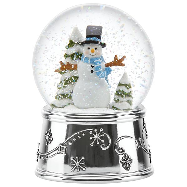 Holiday - Snowman Holiday Musical Snow globe by Reed & Barton  A smiling snowman stands in the midst of snow covered trees inside the Snowman Holiday Musical Snowglobe from Reed & Barton. Crafted in shimmering silver plate, this elegant snowglobe will add both beauty and music to your holiday décor. Plays