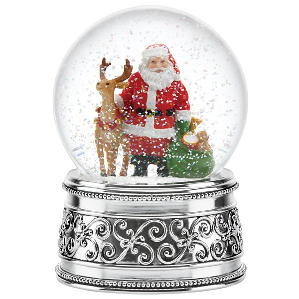 Holiday - Santa & Reindeer Musical Snow globe by Reed & Barton    Mr. Claus stands beside his favorite reindeer holding his bag of toys inside the Santa and Reindeer Holiday Musical Snowglobe from Reed & Barton. Crafted in shimmering silver plate, this elegant snowglobe will add both beauty and music to your holiday décor. Plays