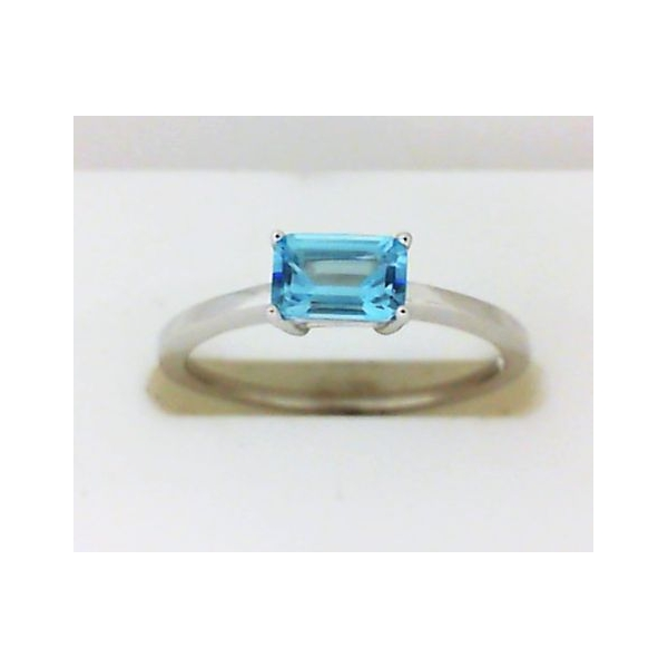 Ring - White 14K Solitaire Ring With One 6.03X4.09Mm Emerald Cut Topaz