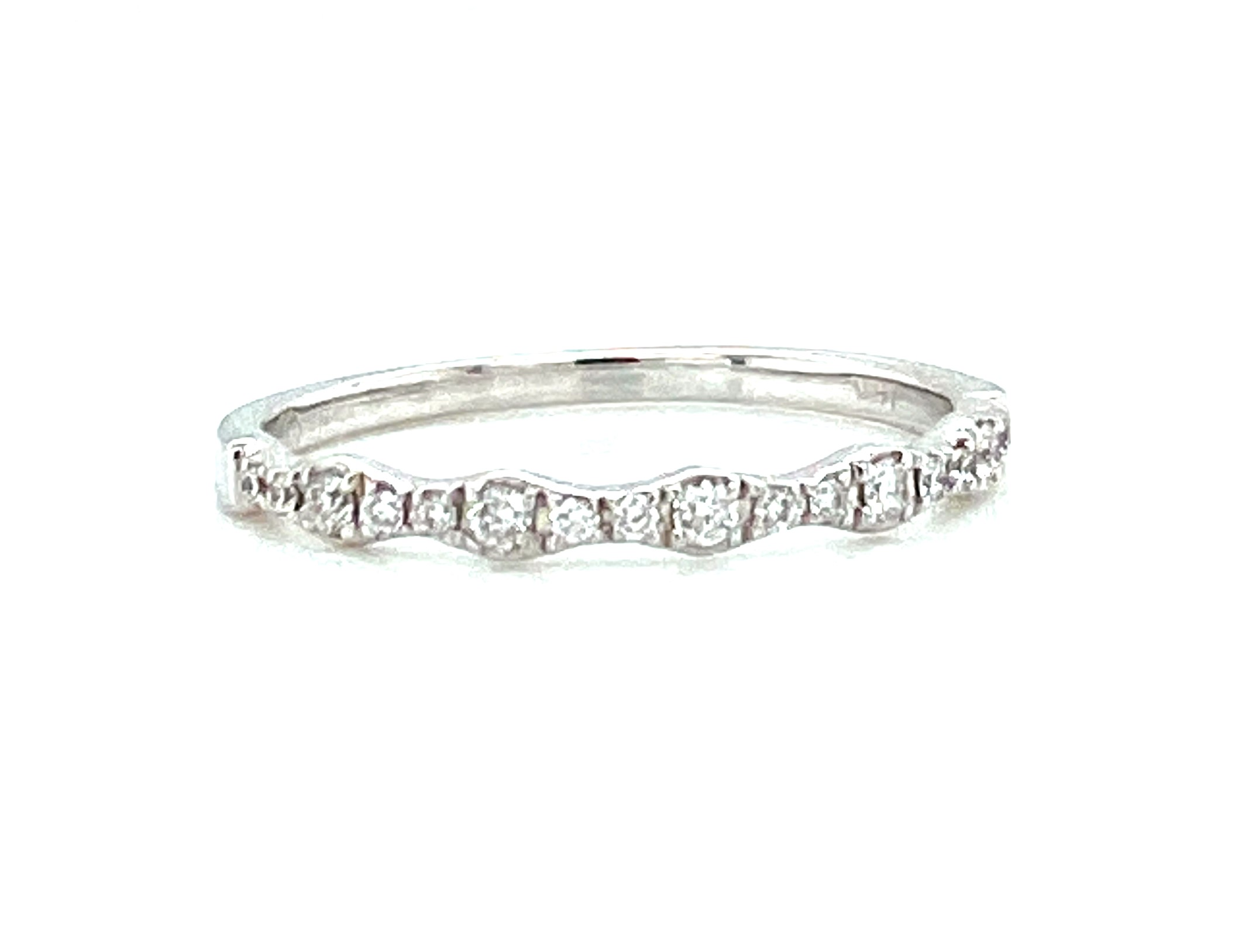 Diamond Wedding Band - Ladies 14 karat white gold high polished diamond wedding band. This band features 17 prong set round brilliant cut diamonds.  The diamonds are G-H color, VS2-SI1 clarity and weigh 0.15 ct.  The band weighs 1.20 grams and is size 6.50.