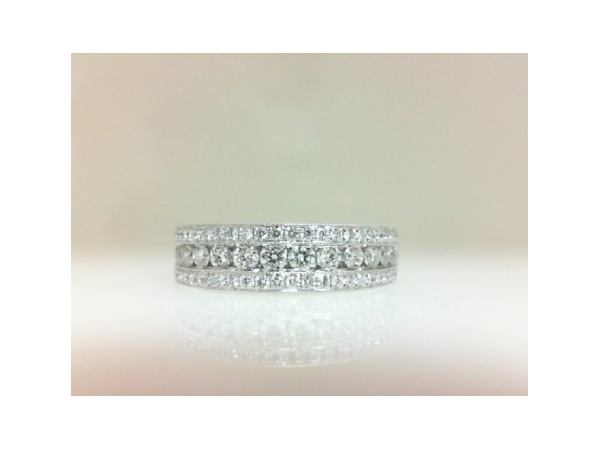 Diamond Wedding Band - Ladies 14 karat white gold diamond wedding band.  This ring features 68 channel and bead set round brilliant cut diamonds totaling 0.73 ct. The hearts and arrows diamonds are G-H color, SI1-2 clarity. This ring is a size 6.50 and weighs 5.90 grams.