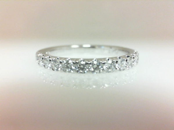 Diamond Wedding Band - Ladies platinum diamond wedding band.  This ring features 17  micropave set round brilliant cut diamonds totaling 0.57 ct.  The diamonds are G-H color, SI1-2 clarity.  This ring is a size 6.25 and weighs 3.80 grams.