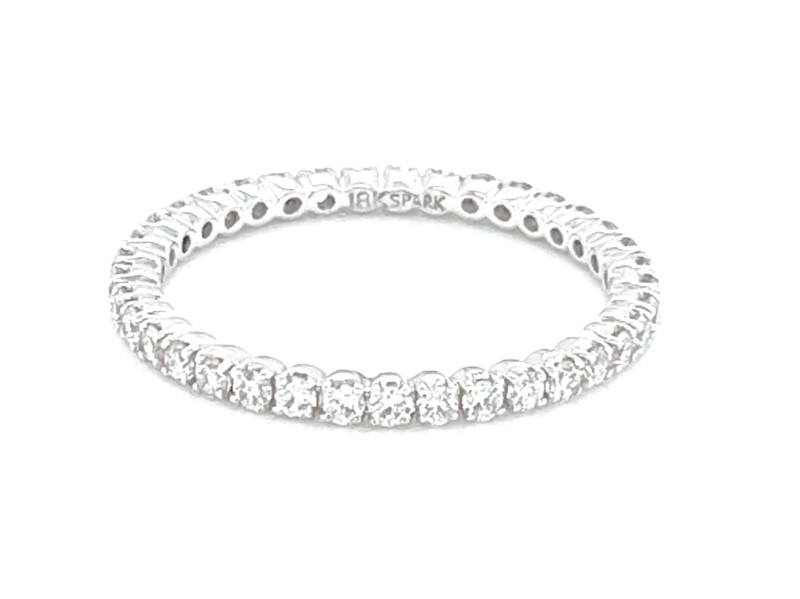 Diamond Eternity Ring - Ladies 18 karat white gold high polished diamond eternity band.  This band features 37 prong set round brilliant cut diamonds.  The diamonds are G-H color, VS1-2 clarity and weigh 0.55 ct.  This ring weighs 1.40 grams and is size 6.00.