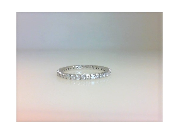 Diamond Eternity Ring - Ladies 18 karat white gold high polished diamond eternity band.  This band features 37 prong set round brilliant cut diamonds.  The diamonds are G-H color, VS1-2 clarity and weigh 0.33 ct.  This ring weighs 1.30 grams and is size 6.00.
