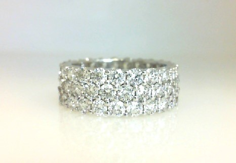 Diamond Eternity Ring - Ladies 18 karat white gold high polished diamond eternity band.  This band features 69 shared