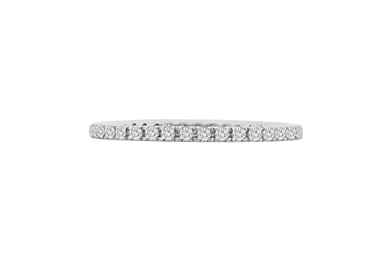 Diamond Eternity Ring - Ladies 18 karat white gold high polished diamond eternity ring.  This ring features 37 prong set round brilliant cut diamonds.  The diamonds are G-H color, VS1-2 clarity and weigh 0.33 ct.  The ring weighs 1.40 grams and is size 6.00.
