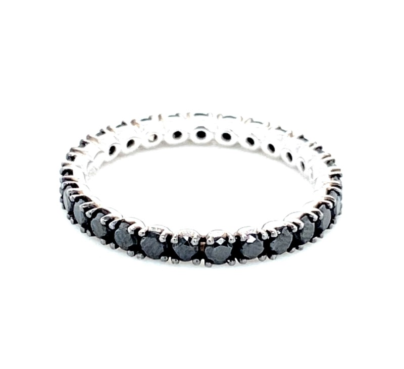 Diamond Eternity Ring - Ladies 18 karat white gold high polished black diamond eternity ring.  This ring features 27 prong set round black round diamonds totaling 1.30 cts .  The ring weighs 2.00 grams and is size 6.00.