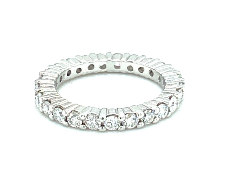Diamond Eternity Ring - Ladies platinum high polished diamond eternity band.  The band features 25  G-H color, SI2-I1 clarity, shared prong set round brilliant cut diamonds totaling 1.00 carat.  The rings weighs 5.10 grams and is size 5.25.