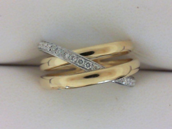 Diamond Fashion Ring - Ladies two tone 18 karat yellow and white gold high polished diamond bypass ring.  This triple row bypass design ring features 26 pave set round brilliant cut diamonds.  The diamonds are G color, SI1 clarity and weigh 0.27 ct.  This ring weighs 5.40 grams and is size 6.50.
