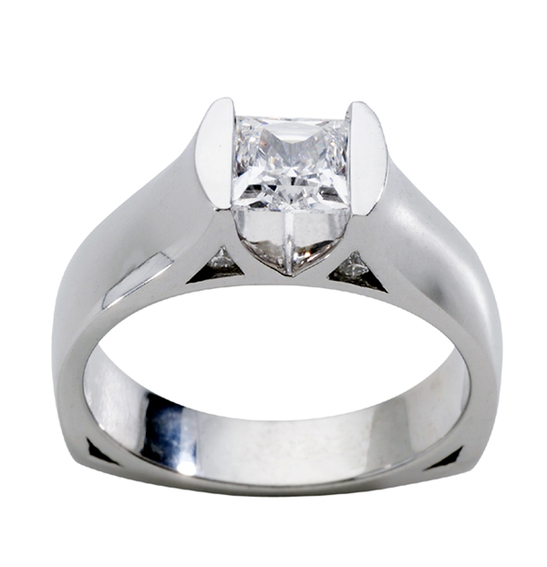 Diamond Semi-Mount Ring - Ladies 14 karat white gold high polished diamond semi- mount ring.  This ring features a tension set mounting with four round diamonds.  The diamonds are G-H color, SI1 clarity and weigh 0.09.  This ring accommodates a 6.50 mm center stone.  This ring weighs 6.40 grams and is size 6.50.