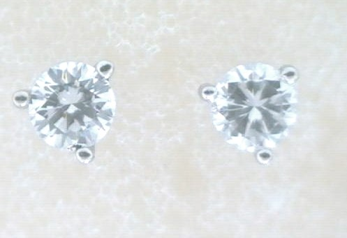 Diamond Stud Earrings - Ladies 14 karat white gold high polished diamond stud earrings.  The earrings feature two martini set round brilliant cut diamonds.  The diamonds are G-H color, SI2 clarity and total 0.50 ct.   The earrings have friction posts and backs and weigh 0.70 gram.