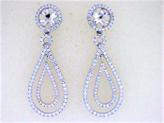 Diamond Earring Jackets - Ladies 18 karat white gold diamond drop earring jackets.  The jackets feature 218 prong set round diamonds.  The diamonds are G-H color, VS1-2 clarity and weigh 1.20 cts.  The jackets measure 1 1/2 inches in length and weigh 6.30 grams.