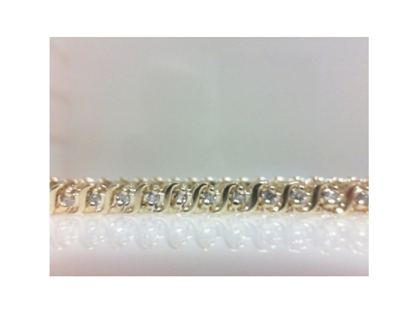 Diamond Bracelet - Ladies 14 karat yellow gold diamond bracelet.  This elegant bracelet features 61 shimmering prong set round brilliant cut diamonds. The diamonds are J-K color, I1-2 clarity and weigh 1.00 ct. This bracelet measures 8.00 inches in length with a hidden clasp and weighs 12.90 grams.