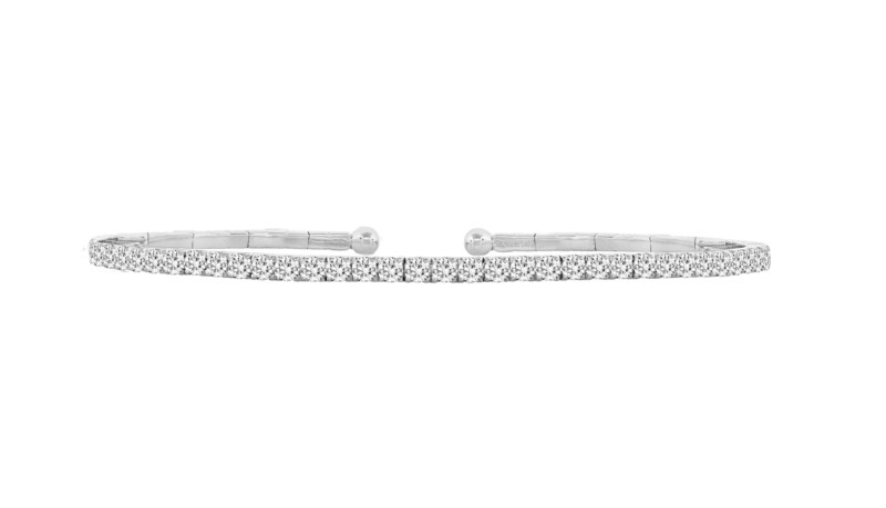Diamond Bracelet - Ladies 18 karat white gold diamond bangle bracelet.  This high polished cuff features 39 prong set round brilliant cut diamonds. The diamonds are G-H color, VS1-2 clarity and weigh 1.15 ct. The bracelet measures 7.00 inches in length and weighs 7.70 grams.