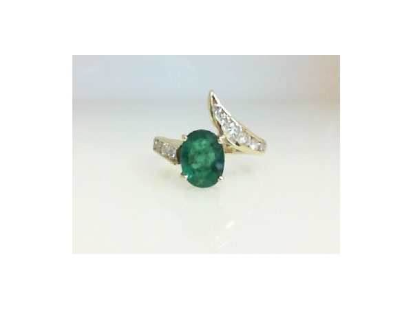 Colored Stone Ring - Ladies 14 karat yellow gold high polished emerald and diamond ring.  This ring features one prong set oval cut emerald totaling 2.00 cts.  Accenting the ring are ten channel set brilliant round diamonds.  The diamonds are G-I color, SI1-2 clarity and weigh 0.40 ct.  This ring weighs 3.60 grams and is size 7.50.