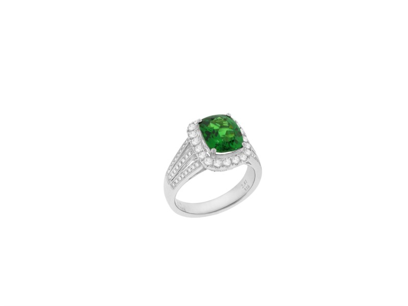 Colored Stone Ring - Ladies 18 karat white gold high polished tsavorite and diamond ring.  This ring features a prong set cushion cut tsavorite garnet totaling 2.81 cts.  The center stone and the milgrain detailed channels on the side of the band are accented with 68 round diamonds.  The diamonds are G-H color, VS1-2 clarity and weigh 0.64 ct.  This ring weighs 7.50 grams and is size 6.00.