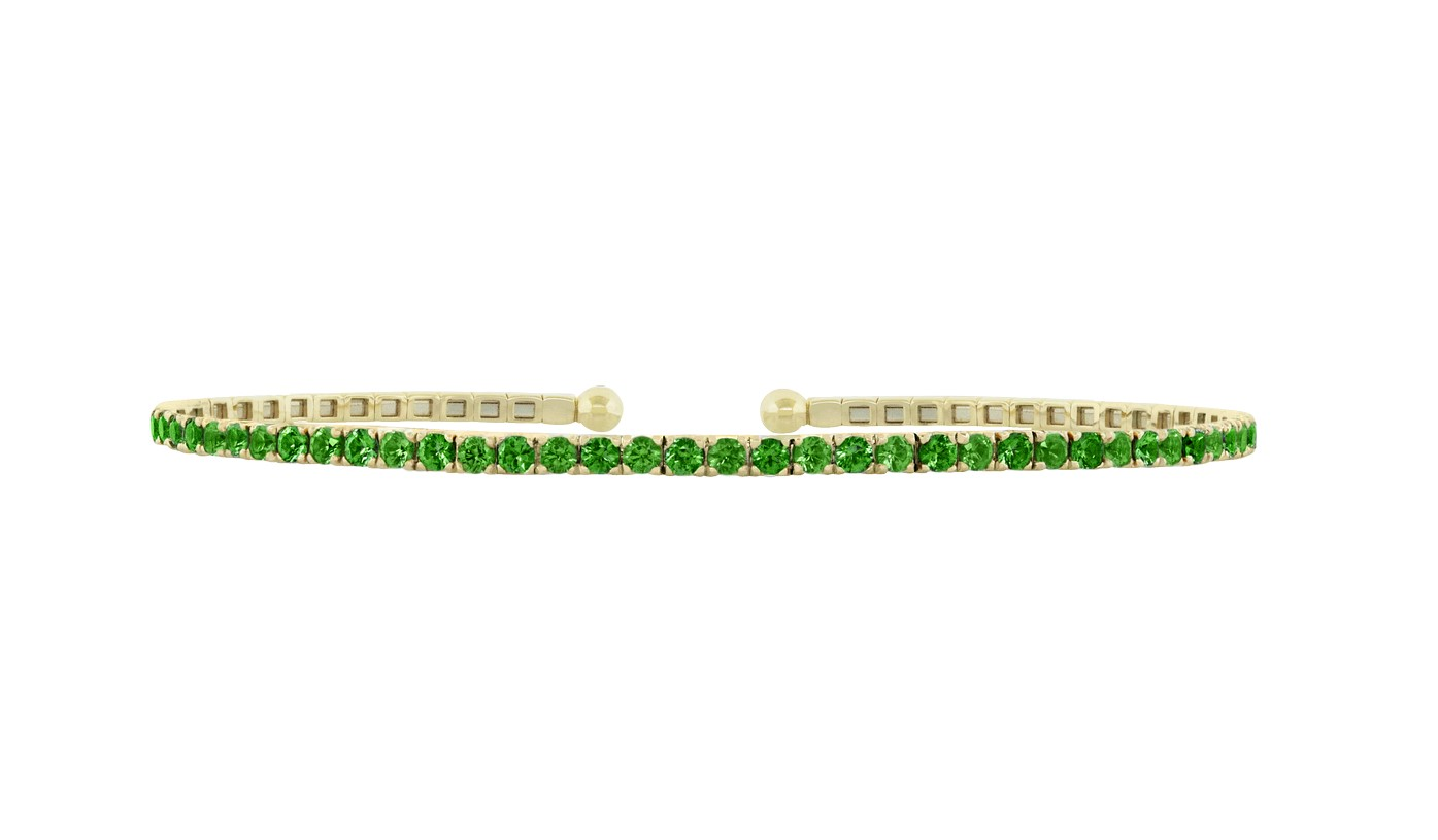 Colored Stone Bracelet - Ladies 18 karat yellow gold tsavorite bracelet.  This high polished cuff features 39 prong set round tsavorites totaling 1.40 cts. The bracelet measures 7.00 inches in length and weighs 7.70 grams.