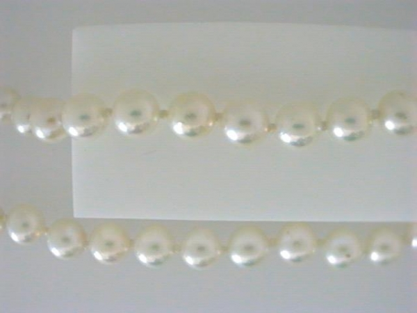 Pearl Necklace - Ladies 14 karat yellow gold pearl necklace.  This necklace features 74 6.00 mm akoya cultured pearls.  This necklace measures 20.00 inches in length with a filigree clasp.