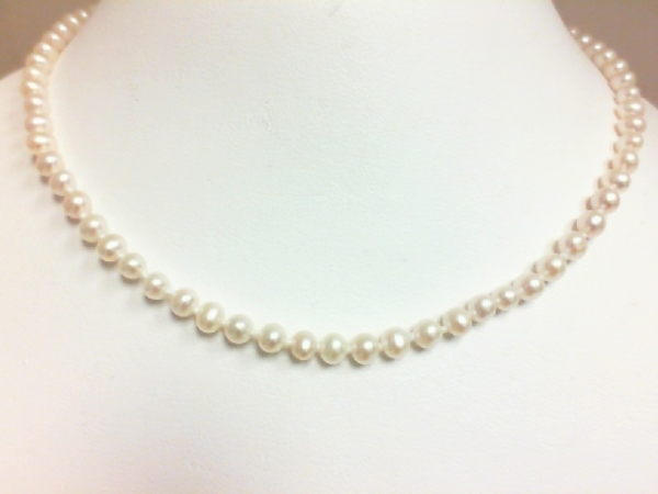Pearl Necklace - Ladies 14 karat yellow gold single strand pearl necklace.  This necklace features 85 -  4.00 - 4.50 mm grade A freshwater pearls.   This necklace measures 16.00 inches with a filigree clasp and weighs 10.40 grams.