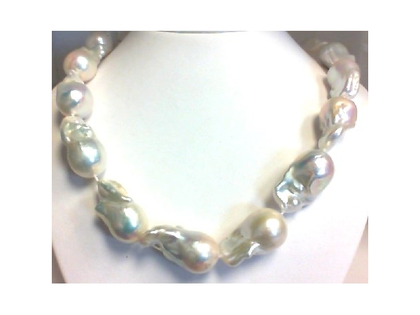 Pearl Necklace - Ladies 14 karat yellow gold high polished baroque freshwater pearl necklace.  This necklace features 15, 15.94 - 18.50 mm white baroque pearls.  The necklace measures 18.00 inches in length with a yellow gold toggle clasp and weighs 149.00 grams.