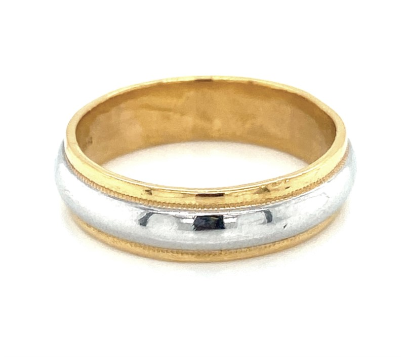 Wedding Band - Gentlemen's  two tone platinum and 24 karat yellow gold wedding band.  This 6.00 mm band features a high polished platinum center bordered with yellow gold milgrain finish beveled edges.   This ring  weighs 12.10 grams and is size 11.00.