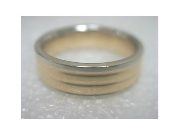 Wedding Band - Gentlemen's platinum and 18 karat gold high polished wedding band.  This 6.00 mm wide band features a yellow gold ribbed center bordered with platinum edges.  This band weighs 11.20 grams and is size 8.25.