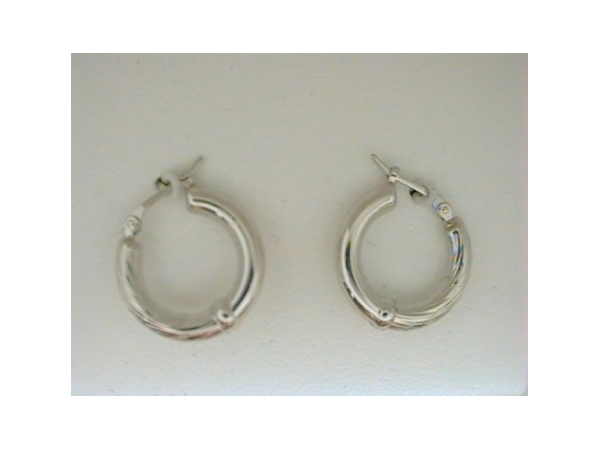 Earrings - Ladies 14 karat white gold high polished hoop earrings.  These life ring hoop earrings measure 16.00 mm in diameter with snap down backs and weigh 1.30 grams.