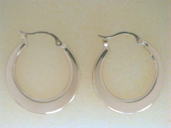 Earrings - Ladies 14 karat yellow gold high polished flat hoop earrings.  The circular earrings measure 3/4 inch in diameter with snap down backs.  The earrings weigh 1.20 grams.