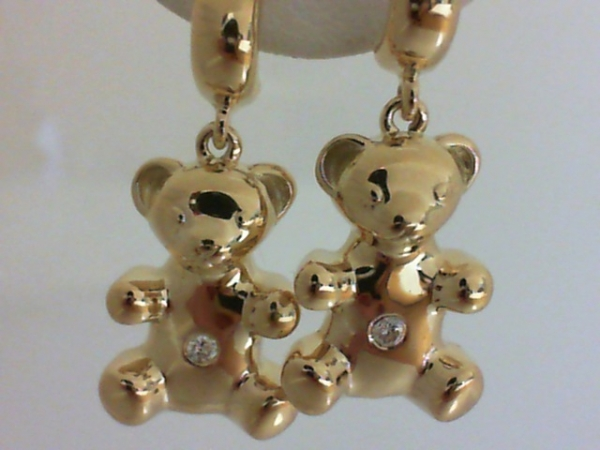 Earrings - Ladies 14 karat yellow gold high polished teddy bear earrings.  These earrings feature two gypsy set round brilliant cut diamonds.  The diamonds are G-H color, SI1 clarity and weigh .06 ct.  The earrings measure 1.00 inch in length and weigh 7.20 grams.