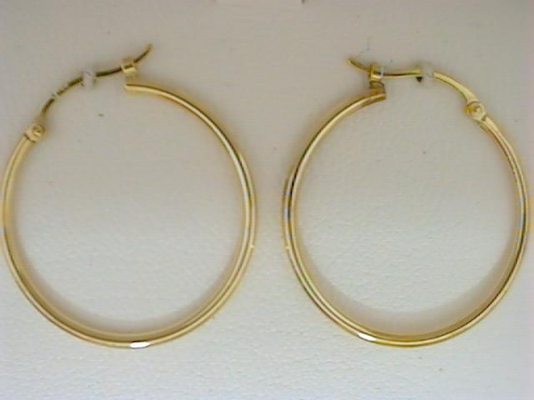 Earrings - Ladies 14 karat yellow gold high polished large narrow hoop earrings.  The tube hinged back hoop earrings measure 25.00 mm in diameter and weigh 1.00 grams.