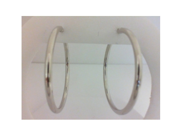 Earrings - Ladies 14 karat white gold high polished large hoop earrings.  The tube hoop earrings measure 40.00 mm in diameter with hinged closure.  The earrings weigh 2.60 grams.