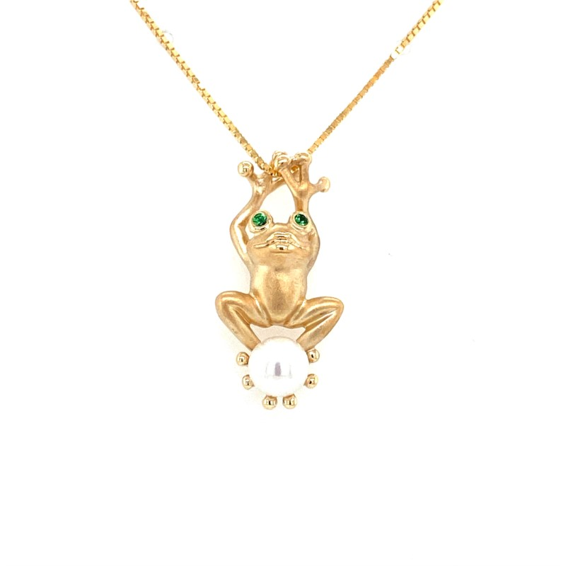 Pendant - Ladies 14 karat yellow gold high polished and frost finish tree frog pendant.  This whimsical frog pendant features one 6.00 mm cultured pearl.  The frog is accented with two bezel set 1.50 mm round tsavorite eyes.  This pendant measures 1.00 inch in length and weigh 3.40 grams.