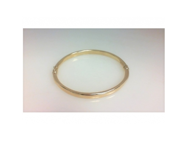 Bracelet - Ladies 14 karat yellow gold hinged bangle. This high polished hinged bangle measures 7.00 inches in length and weighs 4.07 grams.