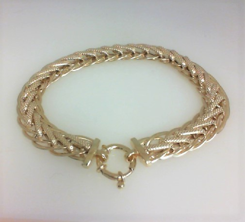Bracelet - Ladies 14 karat yellow gold fancy link bracelet. This high polished and textured fancy link bracelet features a spring ring clasp. The bracelet  measures 7.50 inches in length and weighs 6.91 grams.
