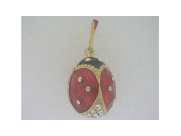 Enamel With Crystals Faberge Egg Pendant - Ladies sterling silver with 24 karat gold gild red and black ladybug pendant.  This faberge pendant features a lady bug design accented with 26 pave set round swarovski crystals.   The pendant measures 1 inch in length and weighs 7.20 grams.
