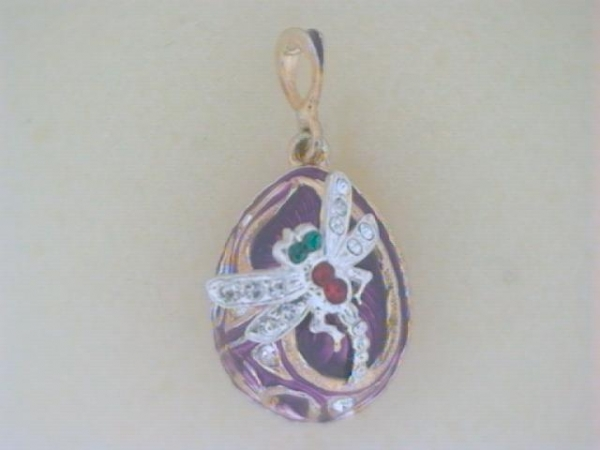 Enamel With Crystals Faberge Egg Pendant - Ladies sterling silver with 24 karat gold gild purple enamel dragonfly egg pendant.  This faberge pendant features a purple enamel background with a dragonfly design.  The pendant is accented with 19 clear, 2 red and 2 green pave set swarovski crystals. The pendant measures 1.00 inch in length and weighs 9.40 grams.