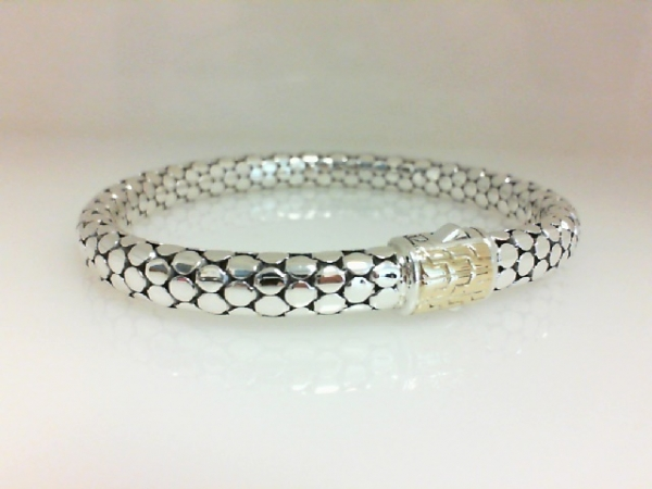 Fashion Bracelet - Ladies sterling silver and 18 karat yellow gold Dot Collection bracelet designed by John Hardy. This high polished and detailed bracelet measures 7.50 inches in length and weighs 16.00 grams.