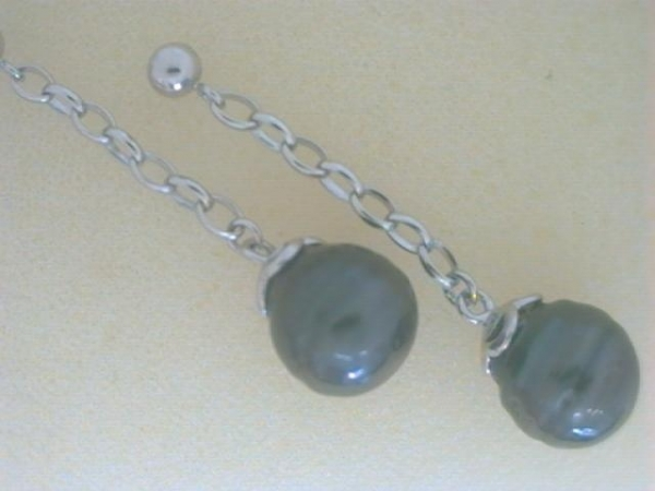 Earrings - Ladies sterling silver tahitian pearl earrings.  These earrings feature two 9.00 - 10.00 mm black tahitian pearls dangling from rolo links.  The earrings measure 1.50 inches in length with friction posts and backs and weigh 4.30 grams.