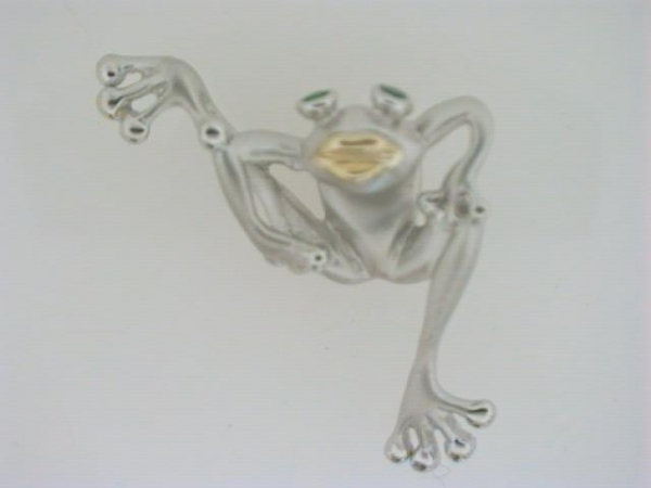 Fashion Pendant - Ladies sterling silver and 14 karat yellow gold hanging tree frog pendant.  This pendant features a satin and polished finish frog with a high polished yellow gold mouth.   This tree frog is accented with two bezel set round tsavorite garnet eyes.  This pendant weighs 2.60 grams.