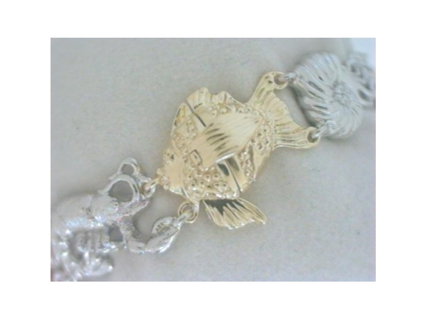 Nautical Bracelet - Ladies sterling silver with rhodium finish and 14 karat yellow gold sealife bracelet.  This bracelet features nine varied design sealife links.  The links are accented with one yellow gold fish design functioning as the clasp.  The bracelet measures 7.25 inches in length and weighs 40.10 grams.