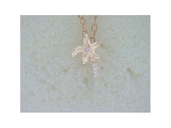 Nautical Pendant - Ladies 14k yellow gold mini palm tree nautical pendant with one 0.05ct round diamond.0.4 grams.