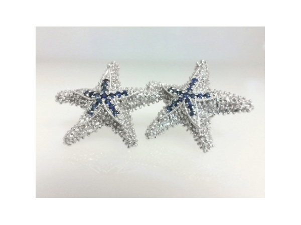 Nautical Earrings - Ladies precious silver sapphire starfish earrings. These high polished and detailed earrings feature 32 prong set round blue sapphires totaling 0.20 ct. The friction post and back earrings measure 0.75 inch in length and weigh 0.36 grams.