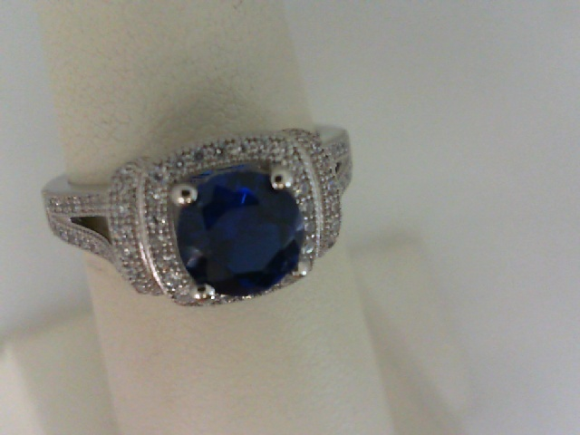 Ring - 18kt White Gold Over Sterling Silver Ring with Simulated Diamonds and Simulated Sapphire
