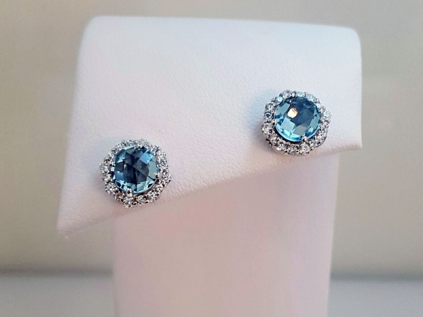Sterling Silver Blue Topaz & CZ Earrings - Sterling silver round blue topaz and CZ earrings