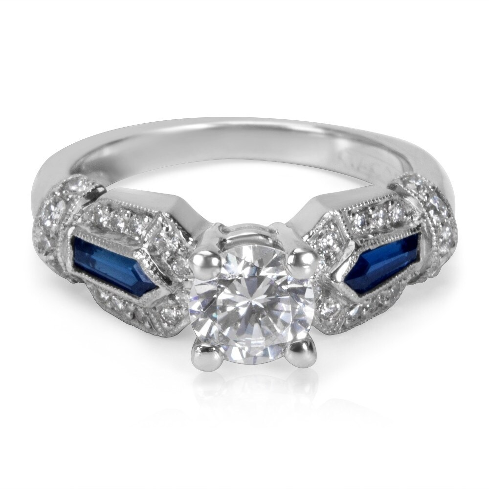 Engagement Ring - TACORI BA 4278 Platinum Engagement Ring with .30ct tw Clarity Grade: VS2, Color: G-H Diamonds, 2 x 6mmx2mm Tapered Baguette Blue Sapphires = .40ct, Size 6.5 (6mm Round CZ Center, 6mm Round center Diamond not included in price but we have plenty for you to choose from) Limited availability, only one at this price. (we're not affiliated with Tacori but are selling genuine Tacori Rings at tremendously reduced prices) Certificate of Authenticity included