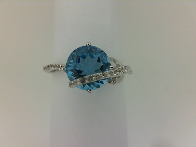 Fashion Ring - Lady's White Sterling Silver Fashion Ring Size 7 With One 2.00Ct Round Blue Topaz And 21=0.08Tw Round White Topazs