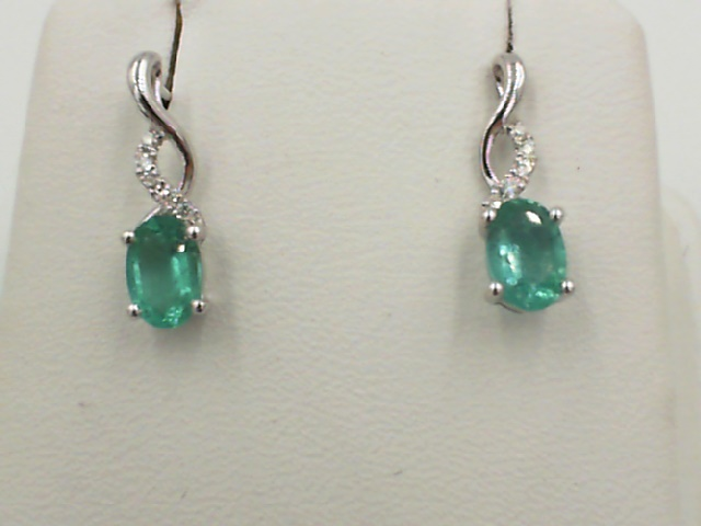 Earrings - Lady's White 14 Karat Drop Earrings 1.3 With 2=0.82Tw Oval Emeralds And 10=0.04Tw Round Diamonds
