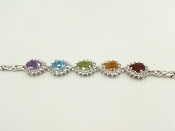 Bracelet - Lady's White Sterling Silver Bracelet one 0.50ct Pear Garnet one 0.50ct Pear Citrine one 0.50ct Oval Peridot one 0.50ct Pear Blue Topaz one 0.50ct Pear Amethyst 1.12tw Round White Topazs